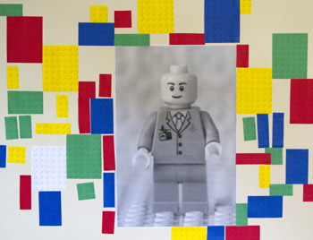 engineering print of LEGO man on wall with LEGO bumps
