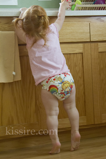 Little in a Rainbow Brite fitted diaper