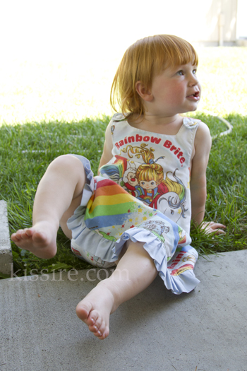 Little in her Rainbow Brite dress and fitted diaper