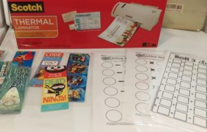 scotch laminator box and laminated projects in front