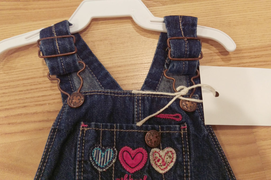 overalls with tag on strap hardware